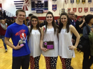 Sophomore Chanler Hughart (left), received the best individual performer award at the 31st Annual Piqua Show Choir Invitational Competition. Also representing the Varsity Singers during the Daytime Awards Ceremony were seniors Kelsey Zimmerly, Bri Agner and Emily Keckler. (Photo submitted)