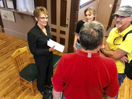 Several Ada council members talk with new fiscal officer Keri Mclaughlin (far left) following a recent council hearing at the Depot - Ada Herald