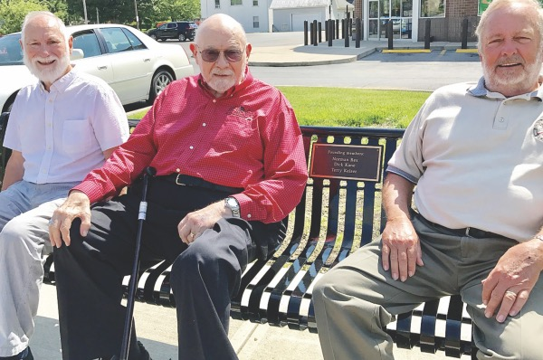 Founding Tree Commission members (left to right): Dick Kane, Norman Rex and Terry Keiser, sit on the new bench dedicated to them and their service. (Ada Herald/Joe Schriner)